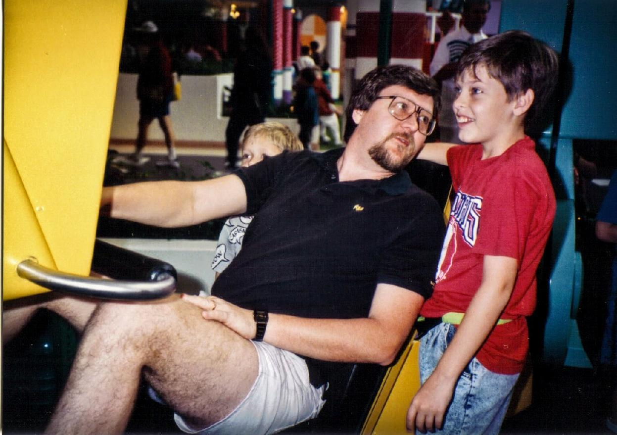 Dad and me (with my brother in the background) at EPCOT Center in the early 1990s